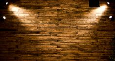 DIY pallet wall with some added light to make the texture pop.