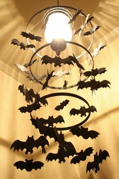 Pin for Later: 60+ of the Most Spooktacular Halloween DIYs Bat Chandelier Your light fixture can be easily turned into a spooky bat chandelier with a quick DIY!  Source: A Diamond in the Stuff