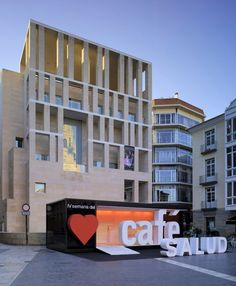 Coffee and Literature Stand / Clavel Arquitectos A fold -down front. Looks simple and well designed! popuprepublic.com