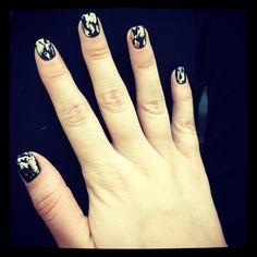 Black shellac with gold foils
