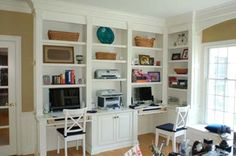 built in bookcases with two desks