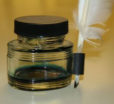 Quill and ink bottle. Link accompanies a good Wikipedia article on how quills are made and used.
