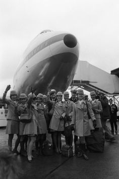 FILE - In this Jan. 12, 1970 file photo, the crew of a Pan Am Boeing 747 Jumbo Jet pose for photographer in front the nose of the plane afte...
