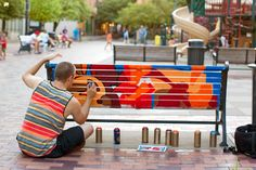 Painted benches, many stories: Since the UICCU BenchMarks program began in 2012 to paint downtown Iowa City benches, many Hawkeyes have had a hand in designing, painting and promoting the work.