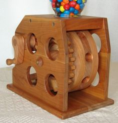Woodworking encompasses a broad area of skills, specialties, and applications. Some beginners take on too much too soon or blow their savings on expensive woodworking tools and machines that they don' Woodworking Projects For Kids, Woodworking Jigs, Woodworking Furniture, Wood Projects, Marble Machine, Candy Dispenser, Gumball Machine, Wood Toys, Homemade Christmas