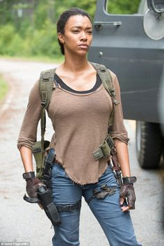 Ready for action: Sonequa Martin-Green looks prepared for battle as she has her hand sitting on her gun while looking forebodingly off screen