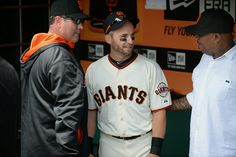 The San Francisco Giants' Marco Scutaro (19) talks with Giant legends Will Clark, left, and Kevin Mitchell, right before the game with the Arizona Diamondbacks at AT&T Park in San Francisco, Calif., on Saturday, July 12, 2014. Scutaro is returning to the starting lineup for the ...