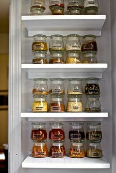 spice shelves w/ glass jars.