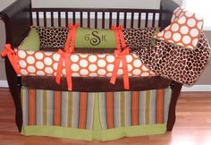 Sahara Baby Bedding  This custom baby bedding set includes the bumper, blanket, and crib skirt. The bumper pad features the minky giraffe, green cotton, large orange dots, stripe piping, and orange grosgrain ribbon ties. The crib skirt features the stripe with a tailored box pleat and border.  The blanket  includes minky giraffe on one side orange dots on the other and stripe piping.