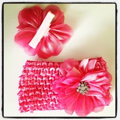 Pink pinkity pink!  Grow with you bow!  One head band for baby girl with barrette.  Then when she gets too old for the band, take the barrette off and use in her pony tails!  One for each!!