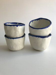 Image of pinched porcelain tumblers