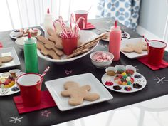 Keep the kids entertained with their own party activity. Set up a gingerbread decorating station, complete with to-go boxes so little ones take the treats with them when they leave. >> http://www.hgtv.com/design/make-and-celebrate/holidays/kids-gingerbread-cookie-decorating-party-pictures?soc=holidaypinparty