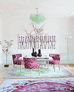 Luxuriate in the Living Room. Pinks, purples, and pale greens come out to play in this game table area. Interior Designer: Rafael de Cárdenas.