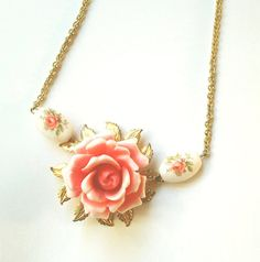 I love the classic elegance and subtle china teacup vibe of this gorgeous necklace.