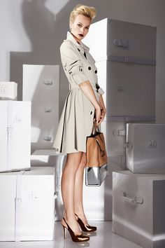 """Look By Escada...  COAT  A feminine take on the traditional trench: figure-flattering wide-belted waist, rear frill detail.  BAG  Shopper in a high-contrast calfskin duo: natural tan with a shiny mirrored-silver base; coin pendant.  SHOES  Slingback pumps in metallic, silver-mirror finish calfskin; hidden plateau in front, 4-1/2"""" heels"""