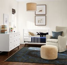 "The Ellery swivel glider offers perfectly proportioned comfort for snuggling with your little one.<span> <a href=""/discover/madeinamerica"" target=""_blank"">#madeinamerica</a></span><span> <a href=""/discover/nursery"" target=""_blank"">#nursery</a></span><span> <a href=""/discover/furniture"" target=""_blank"">#furniture</a></span>"
