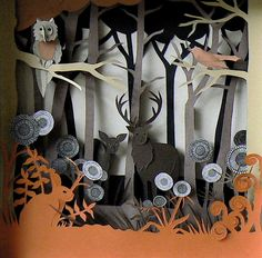 This is a wonderful site full of paper cut creations by Helen Mussel. WOW!