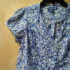 "French Connection Blue Floral Button Up Top French Connection, size 10, in great condition! Only sign of wear is on tag. Print is floral and buttons go half way down the blouse. 20.5"" pit to pit and 22"" length. Please ask any and all questions before purchasing. No trades. Make a reasonable offer. Thanks! French Connection Tops Blouses"