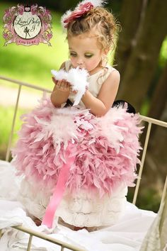 Couture Feather Tutu Skirt - Love all the feathers...just not sure how long they'd stay on that dress with my little ones...lol