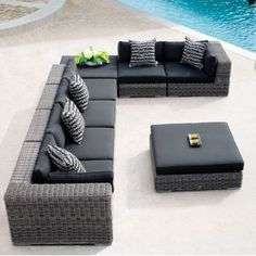 malibu collection -- introducing our modular Malibu outdoor living collection. Multi hued gray synthetic resin rattan with black sunbrella cushions.