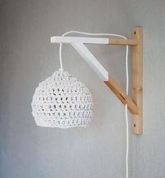 dipped wood wall lamp with crocheted lampshade / See more lighting inspirati.