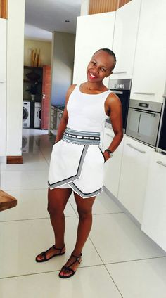 white tank + white and black skort + black sandals African Wedding Dress, African Print Dresses, African Fashion Dresses, African Dress, Fashion Outfits, Xhosa Attire, African Attire, African Wear, African Women