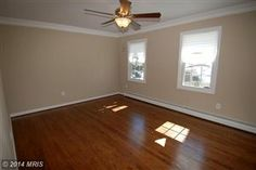 Living Room with new windows, crown molding and hardwoods.COMPLETELY remodeled 3 bed/2.5 Bath Single Family Home in Woodbridge, VA  $289,990  Looking to Sell, Buyer or invest?  Info@AJTeamRealty.com or SellMyHome.NOVA