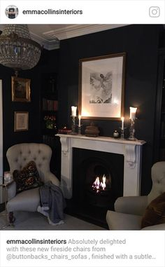 Like the navy blue wall and white fireplace