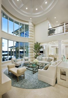 Stunning floor-to-ceiling windows in this gorgeous two story living room at Frenchman's Harbor, FL
