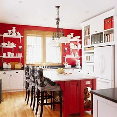 Over 70 Red Kitchen Design Ideas  In the culinary world when you think of red you think of apples,  strawberries, wine, and spices, foods that are tangy and zesty. Big juicy  tomatoes, sweet rosy watermelon, ruby red cranberries and hot chili peppers  inspire cooks and add color and flavor to meals. Red stimulates energy and  sparks the appetite. In other words, red is a super color choice for  kitchens.