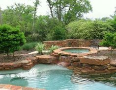 This is a pretty ideal landscape with jacuzzi above tub, some of the houses had this, however I want the pool walls to be smooth not layered rock. - Julieann