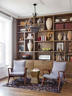Wood finishes are warm and inviting – highlight the unique beauty of the wood by purposefully leaving empty space around collectibles so that the grain is visible, and choose objects in lighter colors and sculptural shapes that stand out against the stain.