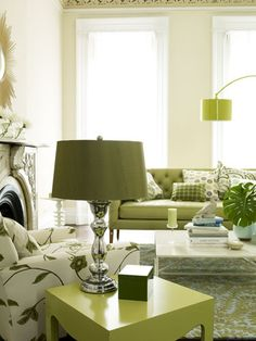 Mixing grass greens on the modern floor lamp and side tables with a mossy-hued sofa and rug creates a laid-back living room look.