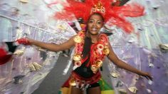 ITN - One of the SiA dancers takes part in the Notting Hill Carnival in west London.