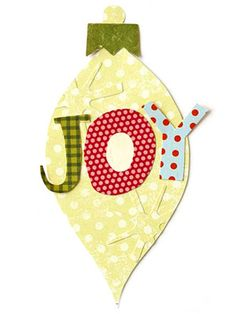 These letters were hand-cut from patterned paper, but you can use our patterns to cut letters from any fun print to spell out a holiday greeting on a simple ornament piecing.