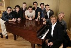 Composer Barry Manilow (foreground on piano bench) and writer Bruce Sussman (background on bench), with director David Warren (next to Sussman) and the male principal cast of Harmony. Barry Manilow, To My Parents, Favorite Person, Picture Video, Musicals, It Cast, Piano Bench, Parker Playhouse, David