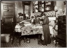 December 1911. Family of Mrs. Mette making flowers in a very dirty tenement. Josephine, 13, helps outside school hours until 9 P.M. She is soon to be 14 and expects to go to work in an embroidery factory. Says she worked in that factory all last summer. Nicholas, 6 years old and Johnnie, 8 yrs. The old work some. All together earn only 40 to 50 cents a day. Baby (20 months old) plays with the flowers, and they expect he can help a little before long. The father drives a coach irregularly.