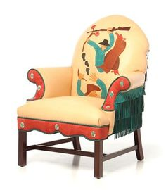APPLIQUE-BACK CHAIR (FALLING COWBOYS)- Upholstered in buttery-soft American Buffalo leather, the Falling Cowboys Chair is one-of-a-kind, commissioned using a design by Western sculptor Lawrence Tenney Stevens from the 1930s.  Stevens was a Thomas Molesworth contemporary, helping define Cowboy High Style.  We've added color, conchos, fringe and braid to our interpretation of Steven's block print of cowboys on a hunt, sliding down a gully.