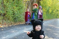 Completely homemade. I made these costumes for my four daughters using fabric from Walmart, a hot glue gun, sewing machine, For Winifreds Sanderson's hair I used a mad hatter wig from Alice In Wonderland and transformed it. I crocheted a black cat hat and cat tail for my youngest. #hocuspocus #costumes #Halloween #Fall #Character #BlackCat #Witch #Cape #halloween2015 #winifredsanderson #SandersonSisters #Homemade #Crafts #MarySanderson #SarahSanderson #binx