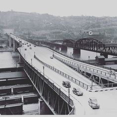 #TBT to the 1940s: the Liberty Bridge, with the Liberty Tunnels and Mt. Washington in the background. Today's #throwbackthursday is from the Allegheny Conference on Community Development Photographs, Detre Library & Archives at the History Center. #libertybridge #libertytunnels #mtwashington #pittsburgh #pittsburghhistory #traffic #heinzhistorycenter #pghtraffic #pittsburghtraffic