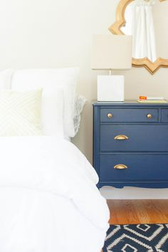Cape Cod Beach House Tour, cream bedroom with navy blue side table, pantone sailor blue, navy blue decor