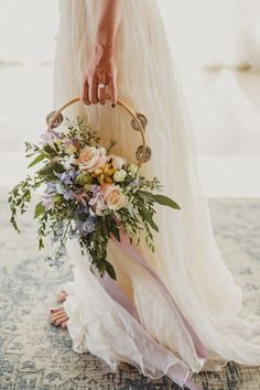 Unique tambourine bridal bouquet with succulents nestled in neutral and pastel tone fresh floral. Baby blue, lavender and peach boho style bouquet. Bride Bouquets, Bridesmaid Bouquet, Non Flower Bouquets, Bohemian Bridesmaid, Wedding Fotografie, Boho Stil, Festival Wedding, Glamorous Wedding, Floral Wedding