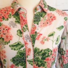"""ODILLE Floral Print Button Up Blouse Gorgeous white button up with spring green and pink floral prints. Lightly cropped sleeves. So fun to accessorize and make your own! By Odille from Anthropologie. Size 2. 100% cotton. Chest measures 38"""". Length 22"""". Sleeve 23"""". Good pre-owned condition with no holes, rips, or stains.  KWs: boho, anthro, vintage vibes, dressy casual, work chic, summer, printed, feminine Anthropologie Tops Button Down Shirts"""