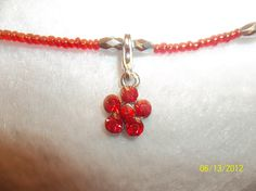 "18"" Red daisy with red seed beads  $12.00"