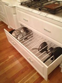 Better Kitchen Organization: File Your Pots and Pans In Drawers! - Better Kitchen Organization: File Your Pots and Pans In Drawers! Drawer Organizing ideas from The - Kitchen Cabinet Organization, Kitchen Drawers, Storage Cabinets, Kitchen Cabinets, Organization Ideas, Storage Ideas, Kitchen Countertops, Cabinet Organizers, Organising Ideas