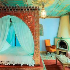 Indian Rustic Happy yet sensual bedroom. Love this! Ceiling, fireplace, light fixture, detail of bedframe, moroccan-syle tile floor, archs....beautiful