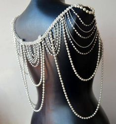 pearl shoulder accessory that will compliment your wedding dress This kind of unique necklace for the shoulders can fit any sleeveless wedding dress. vintage inspired shoulders necklace is completely comfortable, functional and wearable. A lovely addition to any wedding gown This shoulder