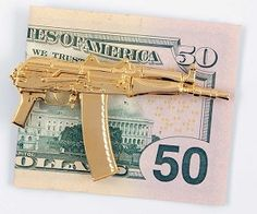Wallets are for chumps, if you really want to tote around your fat stack of dough like a true shot-caller you need the AK-47 money clip. This badass and gold...