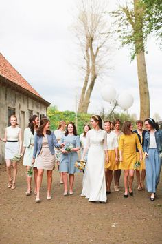 Bride Ingelien gave her friends a colour scheme of yellow and blue and let them choose their own outfits | www.onefabday.com