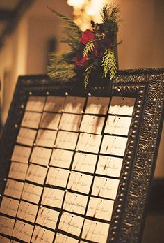 Chic Framed Escort Card Display. Meredith Bach of Lovelee Design created the wedding stationery, including the escort-card display.